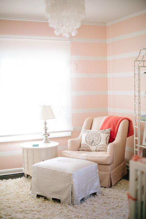 These soft pink-and-white striped walls add just enough interest to the nursery without being too overwhelming. Keep the rest of the decor simple and neutral to keep the room a relaxed retreat. via 100 Layer Cakelet   - HouseBeautiful.com