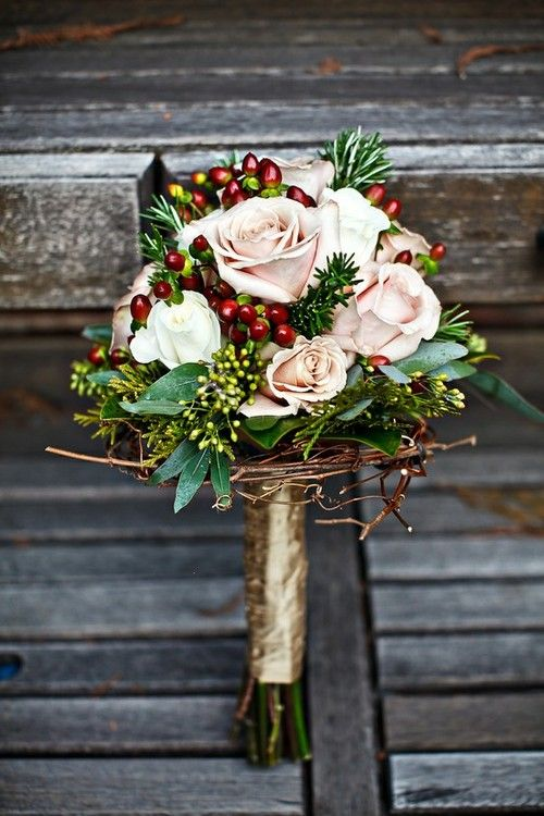 Perfect for a winter wedding, cranberries but with holly added in. Maybe navy coloured flowers