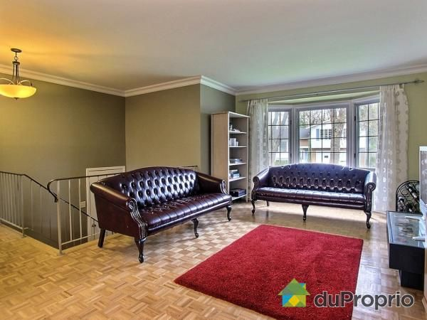 Beautiful open concept living room with bay window and crown moldings. Paint colors: Cobblestone and Sea Grass!