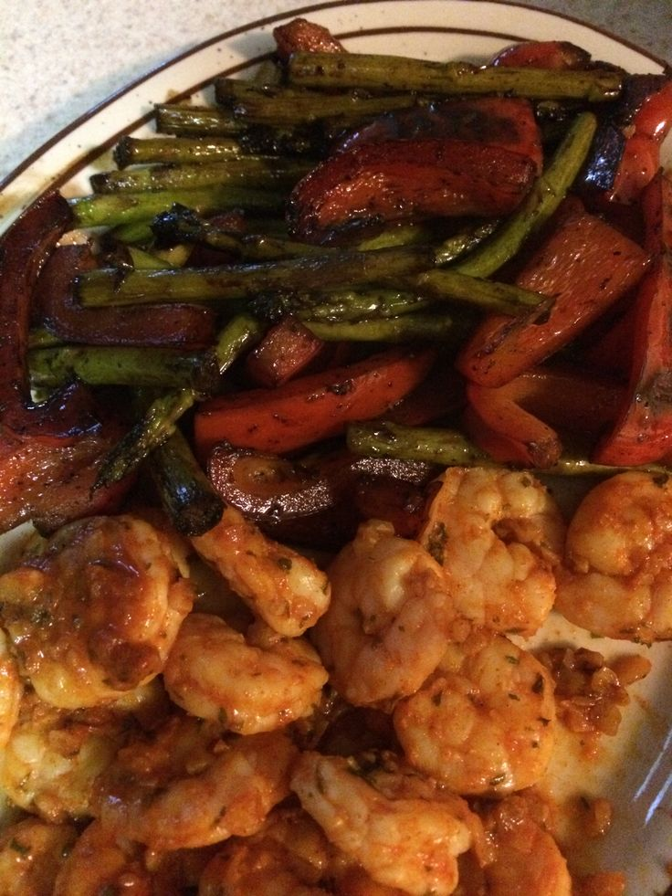 Gambas al ajillo with roasted red peppers and asparagus with balsamic vinegar