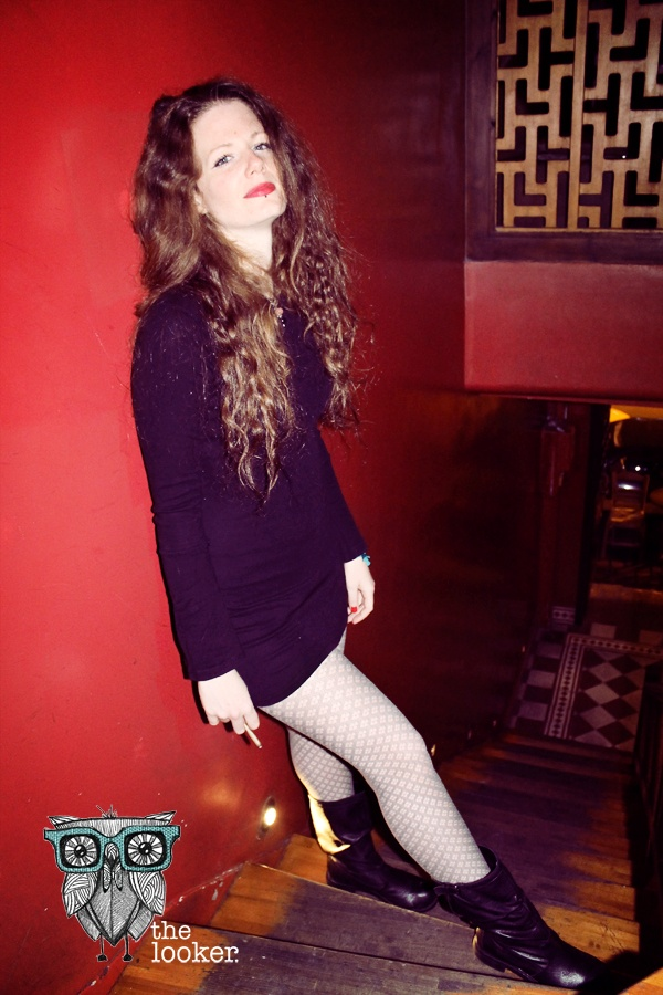 Sexy Grunge.  A tight black mini dress makes a grunge statement when combined with leathern flat boots. The mesh pantyhose and red lipstick prove that a grunge look can be feminine enough for a night out.  http://the-looker.blogspot.com/