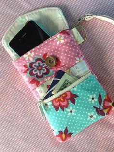 Bolsinha de tecido para telefone celular.