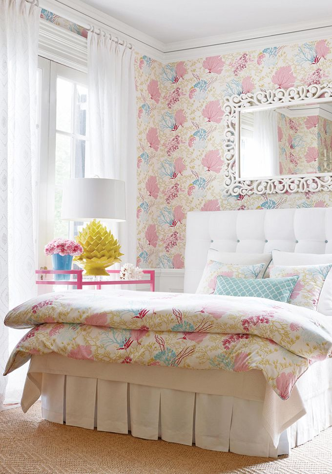 So I am not a huge fan of matching fabric and wallpaper, but this room sure is happy!