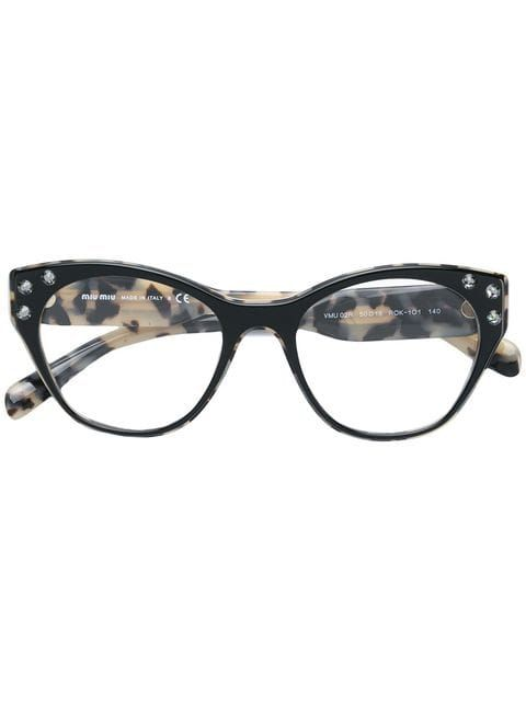 b8932e75c31 Shop Miu Miu Eyewear crystal embellished glasses.
