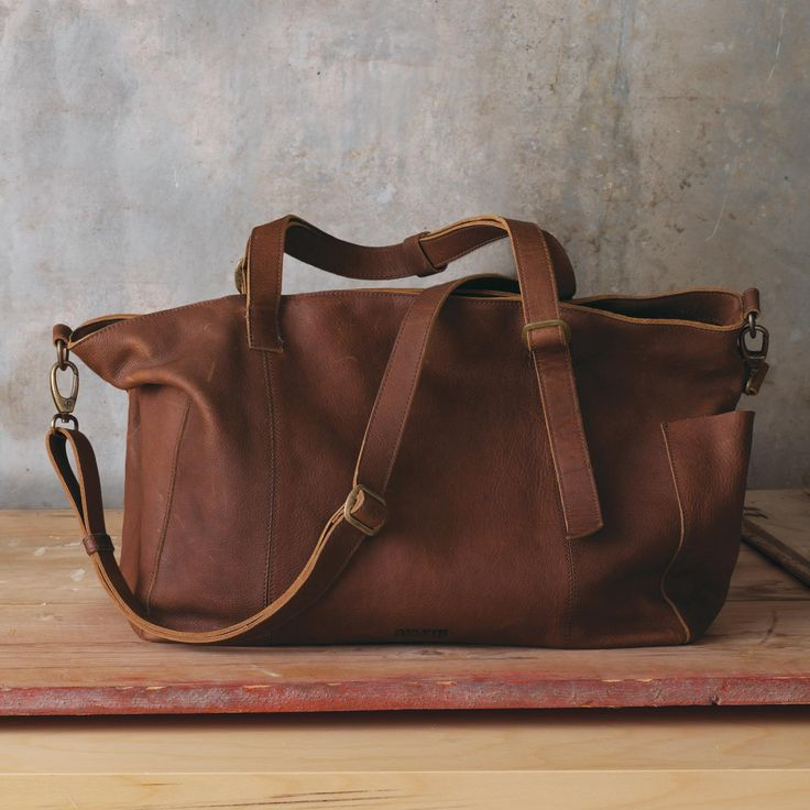 """Open wide and say, """"Wow!"""" You can transport an astonishing volume of stuff in timeless style and perfect organization with this latest addition to the Lifetime Leather family."""