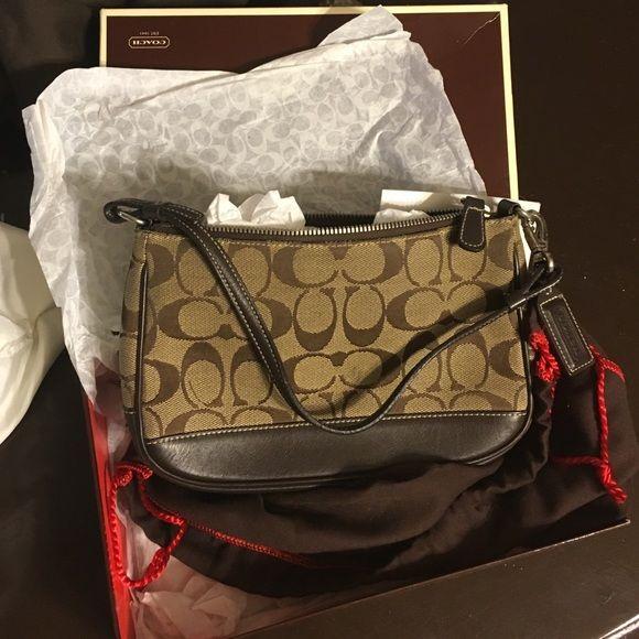 Coach purse Clean coach purse didn't carry much  has box bag tissue and care card Coach Bags Shoulder Bags