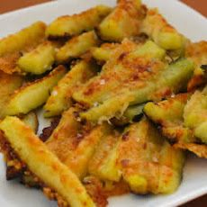 Parmesan Encrusted Zucchini Recipe - I am thinking this would be DELISH in place of green bean casserole for Thanksgiving...