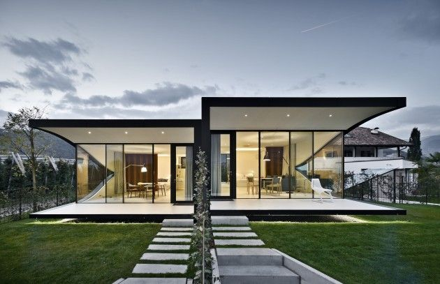 Peter Pichler Architecture have completed some holiday rental homes, surrounded by an apple orchard, near Bolzano, Italy.