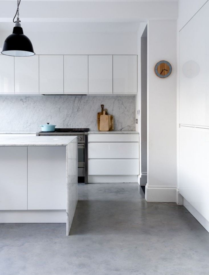 white/grey marble counter & back splash w/white pantry cabinets please. London indoor-outdoor kitchen | Remodelista