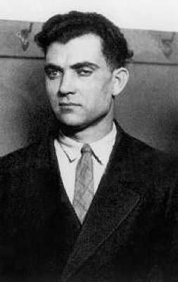 John Scalise served as one of Al Capone's primary hit men during prohibition-era in the 1930s and '40s. When he was twenty years old he lost his right eye in a knife fight, which was later replaced with a glass one.