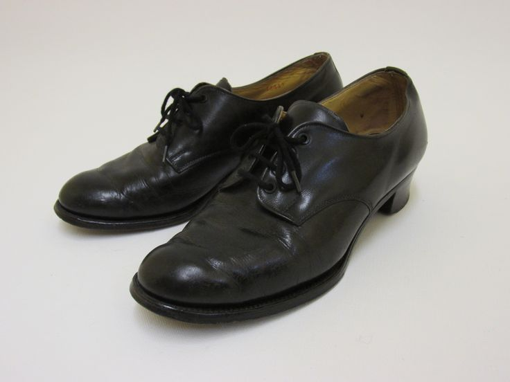 Pair of standard black leather dress shoes worn with a Women's Auxiliary Air Force service dress, 1940s-1960s. From the collection of the Air Force Museum of New Zealand.