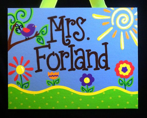 Teacher Door Sign with a Bright Outdoor Theme! This high quality custom sign is hand painted on a flat canvas board, is sealed for protection, and comes with an attached ribbon hanger. Makes a wonderful gift for teachers!  Size - 11 x 14 Sparkle coating available upon request. Please put the name that is to be added in the notes section when ordering.  See all of our other Fancy creations or design your own at www.fancydaydesigns.com