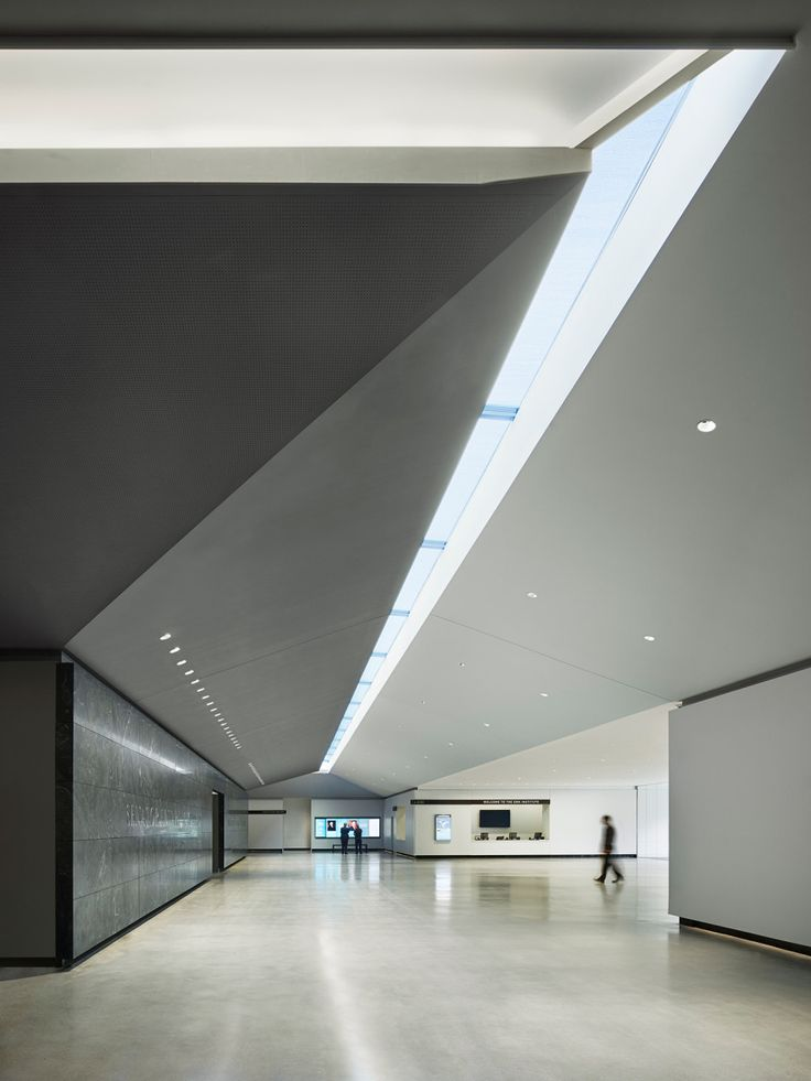 A skylight brings natural light into the lobby. | Lighting ...