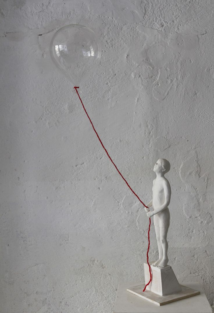 Sculpture of a boy with a baloon by J.Isabelle Cornière, blown glass, resin and wood