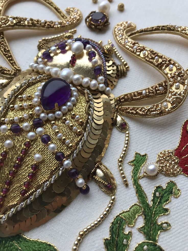 My new work. Louis the Jewel Beetle. With my sincere gratitude to Hanna Karlzon who gave her permission to use her drawing as a pattern for my embroidery. Goldwork embroidery, freshwater pearls, amethysts, garnets, check purl, cords, different seed beads, silk, etc. Size app. 8 by 8 inches (20 x 20 cm)