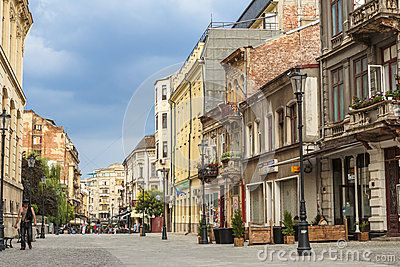 BUCHAREST, ROMANIA - JUNE 1: Unidentified person walks down a cobblestone street in the old historical center Lipscani on June 1, 2012 in Bucharest, Romania.