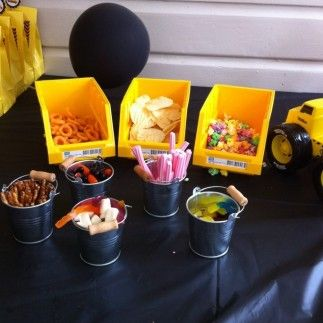 Food served in mini pails and containers from a hardware store at a construction party