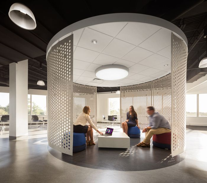 office collaboration space meeting space tables seating circular pods
