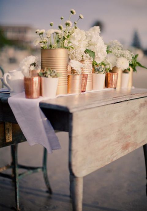 flowers in tin cans (spray painted in metallic colors)