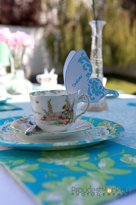 butterfly tea party place cards on tea cups... LOVE this!