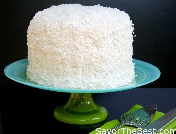 This recipe for coconut cake with awesome coconut butter-cream frosting is a moist white cake with a wonderful creamy, coconut flavored frosting which is smothered with shredded coconut.