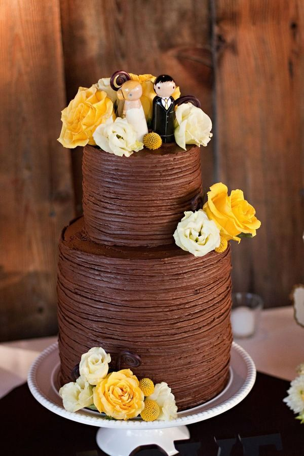 Icing a chocolate wedding cake