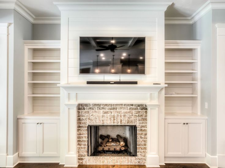 I like the brick and built ins to hide electronics White Cabinetry & White  Shiplap - Fireplace Brick