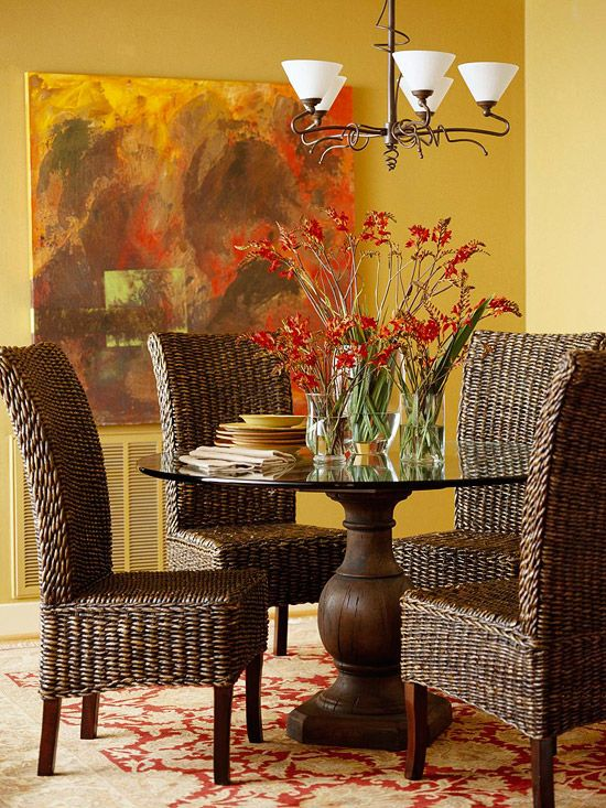Curves, Please,  A round pedestal table is a great fit for a small eating spot. It's easier to squeeze in extra dinner guests than square tables because there are no table legs to knock knees against. It also allows the eye to travel through the room. This setting takes that idea one step further with a barely-there glass tabletop.~~LOVE LOVE the colors colors colors--and the textures!