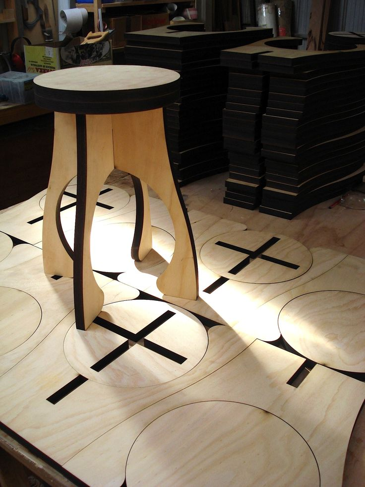"Laser cut plywood stool ""Alien"". Nesting of parts means minimal waste of plantation E0 hoop-pine ply — ten and a half stools per sheet of ply. Alien flat packs for efficient distribution,"
