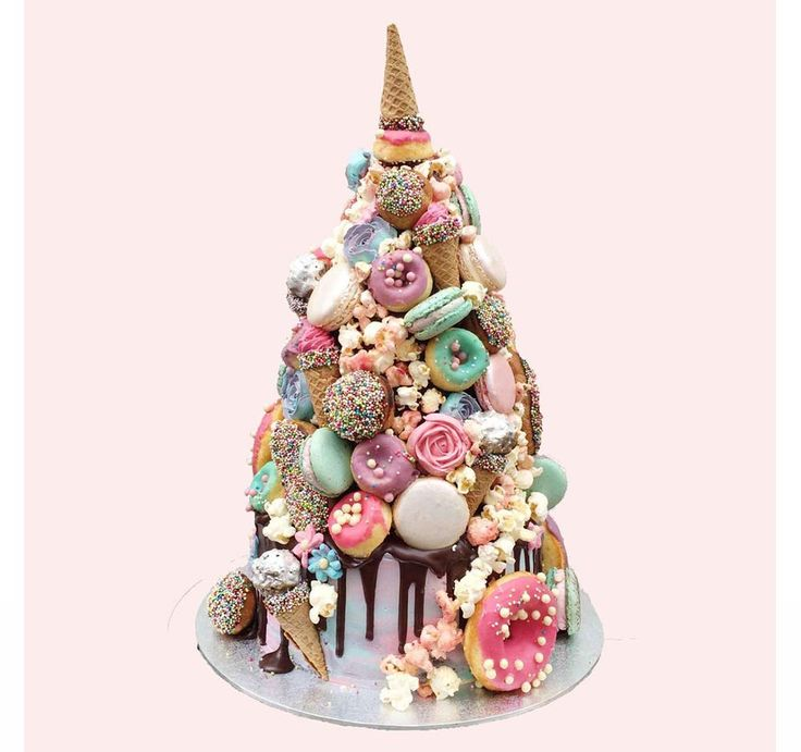 If there was an award for the best cake name ever, it would go to the magical 'Horn of the Unicorn', created by the wonderfully brilliant Anges De Sucre. After already bringing you unicorn wedding ideas, there was no way we could deprive hitched brides from this crazily cool cake. Adorned with popcorn, donuts, ice-cream cones and everything else you could dream of in calorie heaven – it caught our hearts straight away.