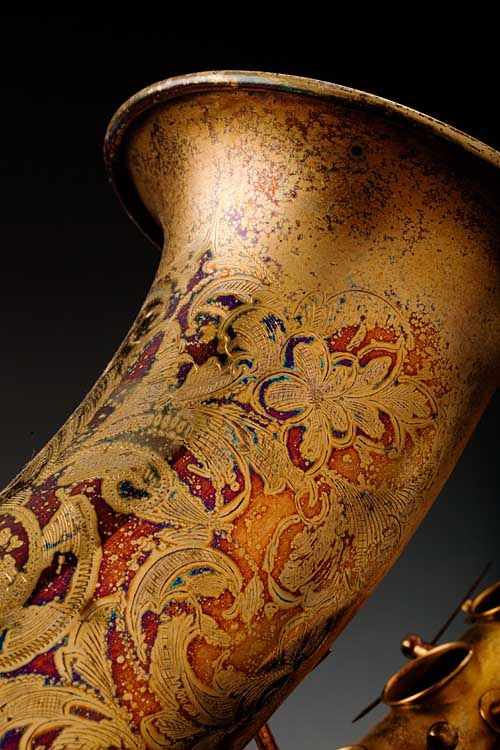 Saxophone_1870    An old Conn C melody saxophone tarnished through the gold plated finish - it displays a wild range of colors.