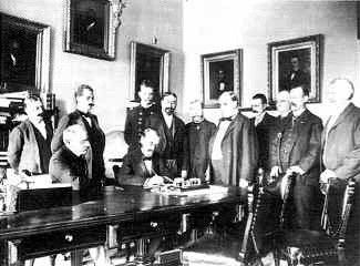 Today in History - July 17, 1898: The Spanish surrender to the United States at Santiago, Cuba, ending the Spanish-American War. The Treaty of Paris is signed the following February, which gives the United States control of Cuba, Guam, Puerto Rico, and the Philippines.