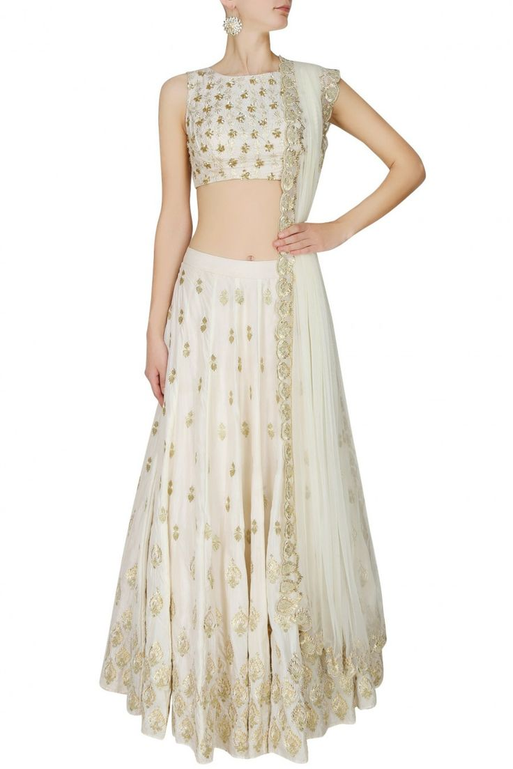 This set features an off white lehenga in silk base with gold gota and sequins motifs all over the front and back. It has a can-can underlayer. It comes along w