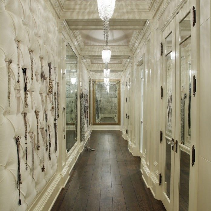 Love love this. Love the upholstered wall to left. Site says it's a jewelry wall/closet...