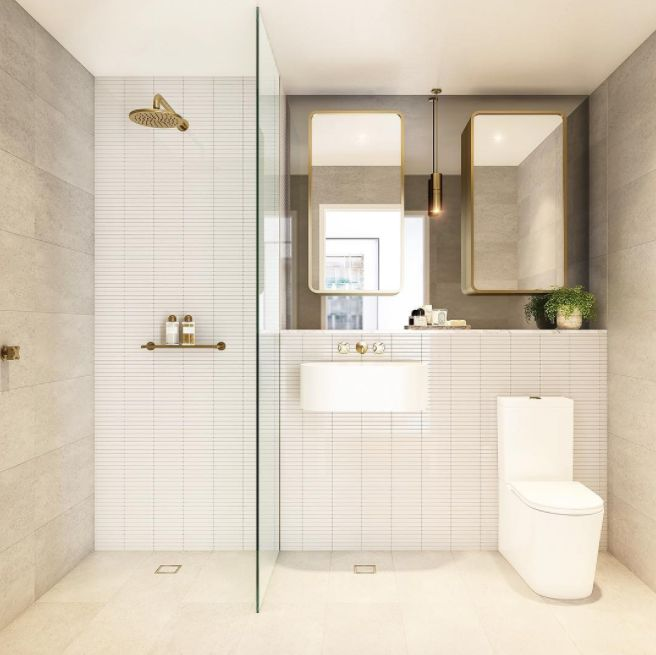 Luxury bathroom with slim white brick mosaic feature wall, brass tapware and bathroom hardware, and tempered glass mirror. Simply stunning bathroom!