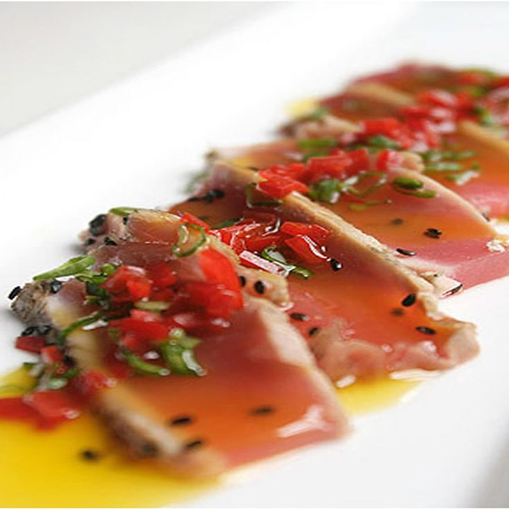 Tiradito is a Peruvian dish of raw fish, cut in the shape of sashimi, and of aspect similar to crudo, and carpaccio, in a spicy sauce.