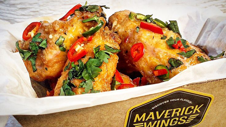 Maverick Wings® - Fresh Lime & Chili Wings, garnished with chopped chili and fresh coriander.