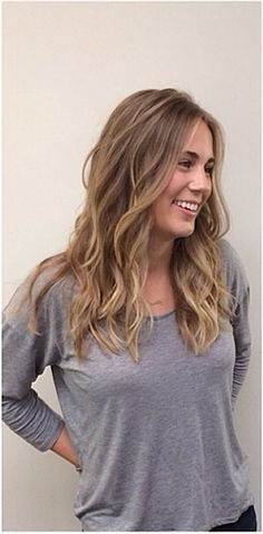 Loving this darker version of sandy blonde by colorist Logan Jackson, with cut and style by Lane Friedman. Having gorgeous hair apparently gives you a reason to smile!