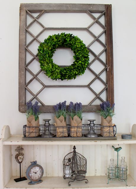 Use an empty antique window frame on the wall as an architectural piece in Rustic Farmhouse Decorating.