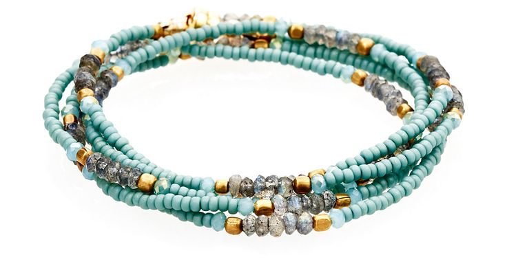 This wrap bracelet features faceted labradorite stones accented with gold plated and aqua beads. This versatile piece looks great wrapped five times as a bracelet and as a long necklace.
