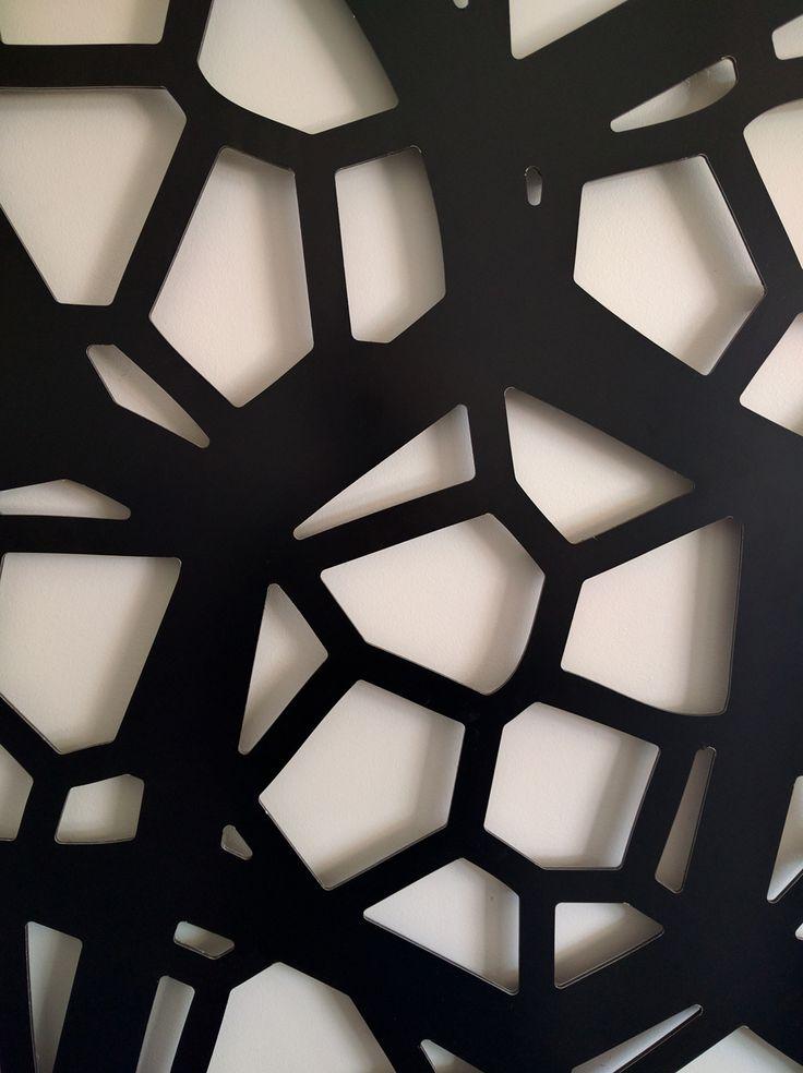 Decorative screen close-up of QAQ's 'Pretoria' pattern in black, powder-coated ACM.