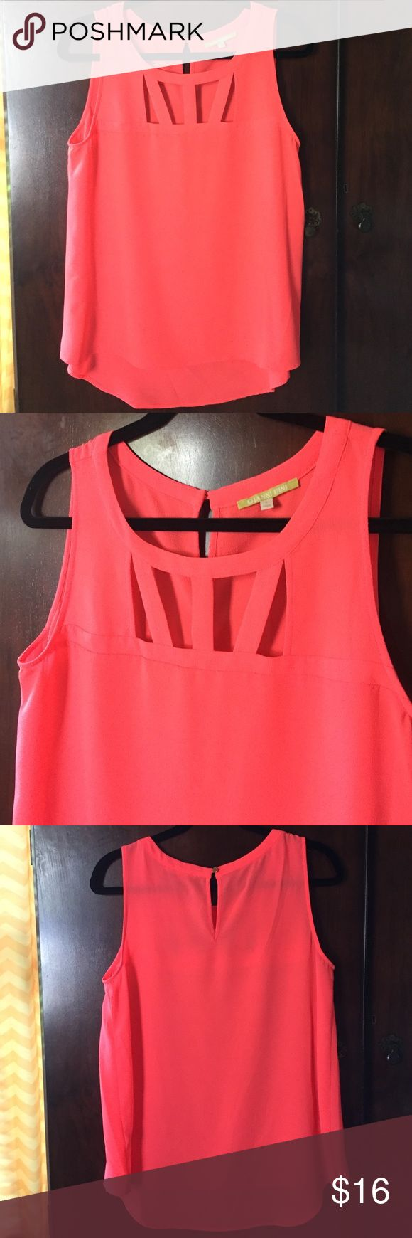 """Gianni Bini Bright Salmon Blouse Sz L Super cute sleeveless top in a bright/neon Salmon color featuring a cut out effect along the front neckline and a keyhole entry back. Not sure I ever wore it, but tags have been removed. 100% Polyester. Like new condition. Armpit to armpit 19.5"""". Please feel free to ask me any questions or make me an offer. Thanks for checking out my closet and remember I offer a great bundle discount! Gianni Bini Tops Blouses"""