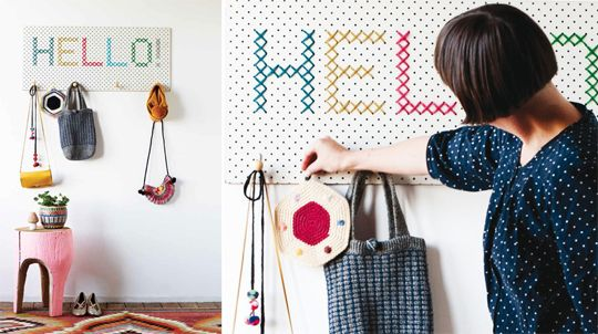 A pegboard coatrack with cross stitch detail by Beci Orpin.