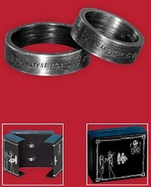 "Nightmare Before Christmas Wedding Bands.  Pumpkin King ring reads, ""My dearest friend, if you don't mind I'd like to join you by your side,"" and the Ragdoll ring reads, ""For it is plain for anyone to see, we are simply meant to be""."