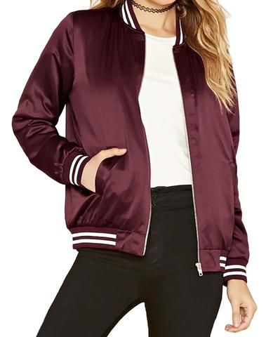 This slightly cropped jacket has that old school look and feel to it. With a Satiny appearance and white stripes around the wrists and collar, it looks like you may have been shopping at a vintage sto