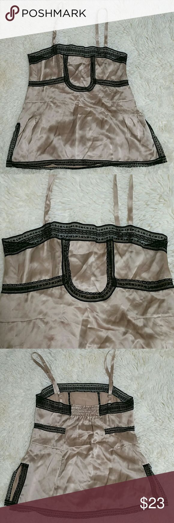 Tracy McWilliams lace & silk cami top Tracy McWilliams lace & silk cami top. Size M. Beautiful nude tone silk cami top with black lace detailing. Smocked back and adjustable straps. Side slits. 100% silk. Gently worn and in perfect condition! Tracy McWilliams Tops Camisoles
