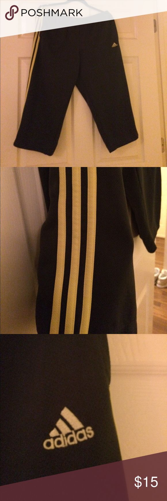 Adidas Capri Pants - Size XL. Adidas Capri Pants - Size XL. These pants are solid gray with neon yellow strips and Adams's symbol. These are more fitted that the mesh Capri Pants. No flaws. Smoke-free and clean home. adidas Pants Capris