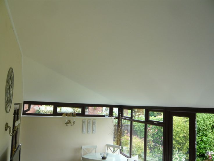 A smooth, white ceiling with clean lines. Quite a transformation for this conservatory roof in Westhoughton!