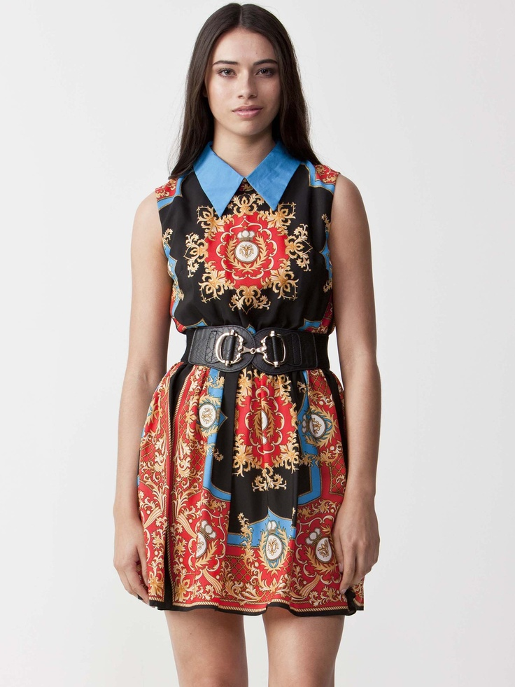 Amber - Oriental Print Dress with collared neckline.  Sleeveless design and ruffled skirt finish.  Enclosed rear zip with button fastening. Belt Not Included. $99.00