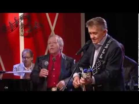 Whispering Bill Anderson  John Conlee - I Wonder If God Likes Country Music. Great group here.